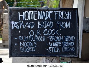 Homemade fresh pasta and bread. Cafe menu, written in chalk on a blackboard