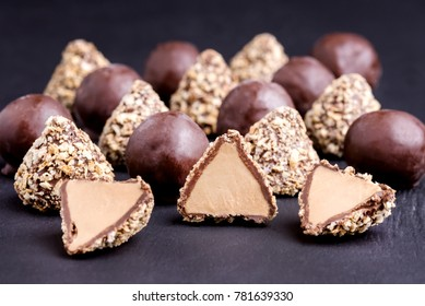 Homemade Fresh Truffle With Cocoa and Peanut Butter Chocolate Candies Black Background Horizontal Close Up
