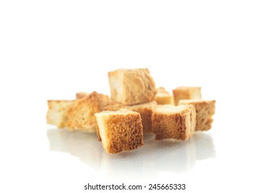 homemade fried bread croutons on a white background