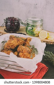 Homemade fried chicken with fresh porato and red cabbage salad