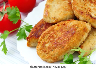 Homemade fried cutlets with fresh vegetables