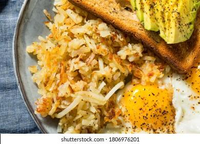 Homemade Fried Shredded Hashbrowns and Eggs for Breakfast