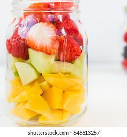 Homemade Fruit and Berry Salads in Jars, Great Idea for Take Away Healthy Snack. Clean or Detox Eating Concept