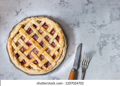 Homemade fruit pie on white stone background.Top view,place for text. Selective focus.