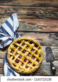 Homemade fruit pie on wooden table.Top view, style rustic. Selective focus.