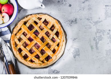 Homemade fruit pie and tea-pot on white stone background.Top view,place for text. Selective focus.