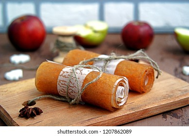 Homemade fruit sweets from mashed apples, traditional Russian winter delicacy. Apple candy, rolled in a roll. Healthy dessert.