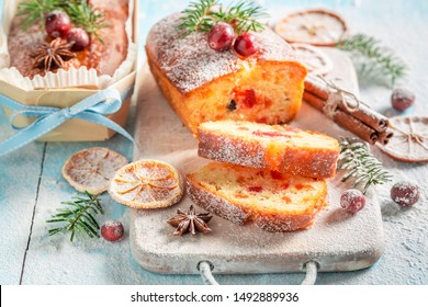 Homemade Fruitcake for Christmas decorated with spruce