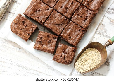 Homemade Fudge Quinoa Brownies on white wooden background, selective focus