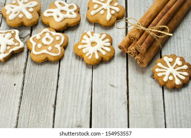 homemade gingerbread cookies with dessert spices on rustic wooden table