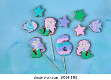 Homemade homemade gingerbread cookies in the shape of a mermaid, fish, stars on a wooden background
