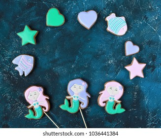 Homemade homemade gingerbread cookies in the shape of a mermaid, fish, hearts on a wooden background