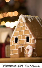 Homemade gingerbread house with blurry festive background