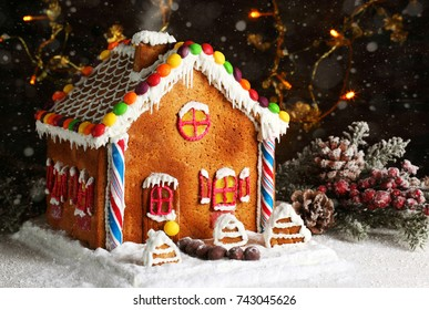 homemade gingerbread house with christmas decorations artificial snowfall