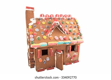 Homemade gingerbread house isolated on white
