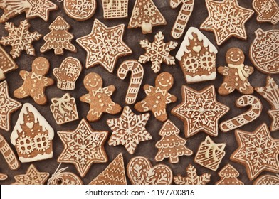 Homemade gingerbread house and gingerbread man cookies, festive Christmas and New Year sweeties background card, toned