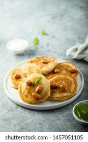 Homemade gluten free pancakes on white plate