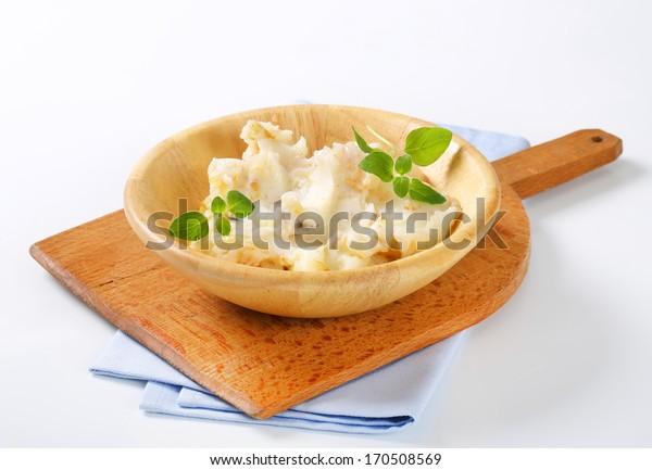 Homemade goose lard in a wooden bowl