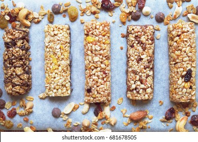 Homemade granola bars on white baking paper. Top view.