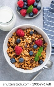 Homemade granola in bowl with berries. Breakfast food, weight loss, nutrition, clean eating concept