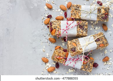 Homemade granola energy bars with figs, oatmeal, almond, dry cranberry, chia and sunflower seeds, healthy snack, top view, copy space