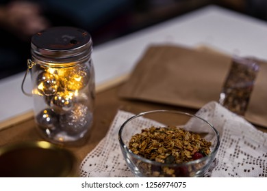 Homemade granola in glass jar on wooden table. healthy breakfast