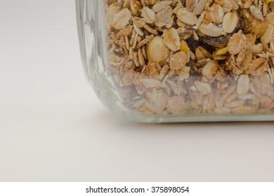 Homemade granola muesli in glass on white