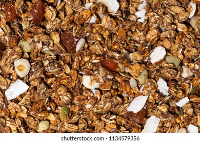 homemade granola with nuts close-up, top view horizontal