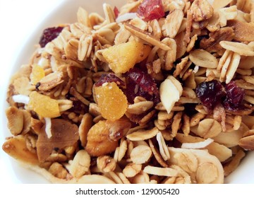 Homemade granola with oats, coconut, cranberries, apricot and almond slivers