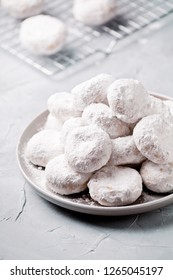 Homemade greek shortbread kourabiedes cookies with almonds and icing sugar