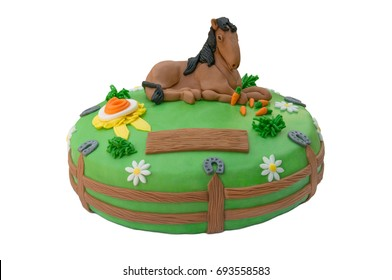 Homemade green birthday cake decorated with a horse isolated on white