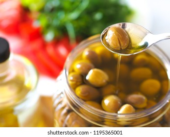 homemade green olives. close-up of organic olives and olive oil in jar