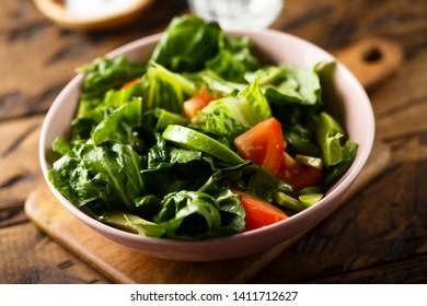 Homemade green salad with tomato and avocado