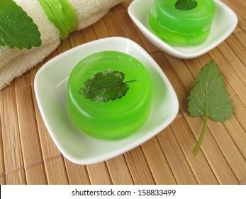 Homemade green soap with lemon balm