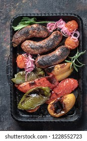 Homemade grilled sausages with bell pepper above