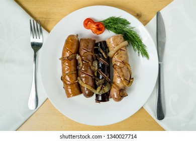 Homemade grilled Sausages with Fried Onion, Ukrainian, Russian and Polish Food