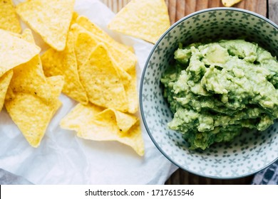 Homemade guacamole with corn chips tortillas - Traditional spicy Mexican preparation