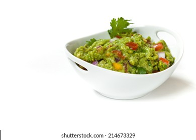 Homemade Guacamole dip on white background. Selective focus.