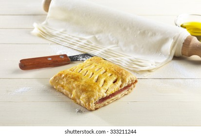 homemade ham and cheese pie and pastry phyllo on a kitchen table
