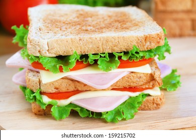 homemade ham sandwich on wood