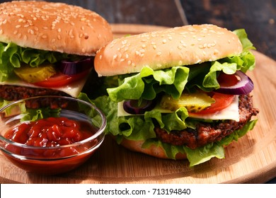 Homemade hamburger with cheese and fresh vegetables