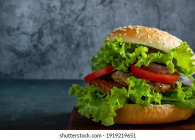 Homemade hamburger with delicious fresh vegetables.