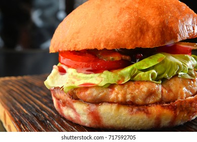 Homemade hamburger with fresh vegetables and chicken