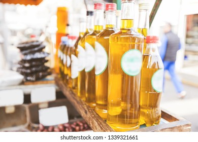 Homemade of hand drawn extra virgin olive oils in glass bottle at farmers marketplace