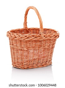 Homemade handmade wicker basket. Isolated on white background with shadow reflection. Empty pannier on white backdrop. Orange skep on white underlay. Domestic handbasket isolated.  Prickle
