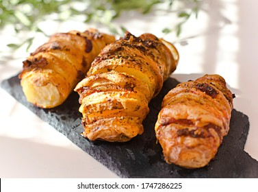 Homemade Hasselback Potatoes with bacon and cheese