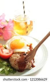Homemade Hawaiian food, Loco Moco served with tomato and lettuce