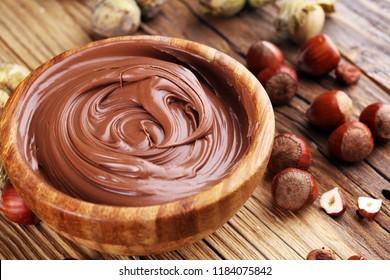 Homemade hazelnut spread in wooden bowl. Hazelnut Nougat cream.