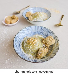 Homemade healthy cold dessert blends of frozen banana,matcha powder topped with toasted ground peanuts and desiccated coconut / Matcha Banana Nice Cream / Eaten with warabi mochi dipped in kinako