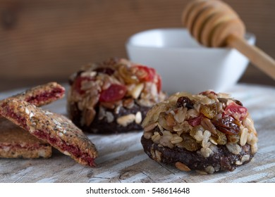 Homemade healthy granola cookies with honey on a wooden background